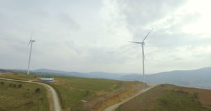Aerial drone view on wind turbine, windmill, energy production in mountains stock video footage
