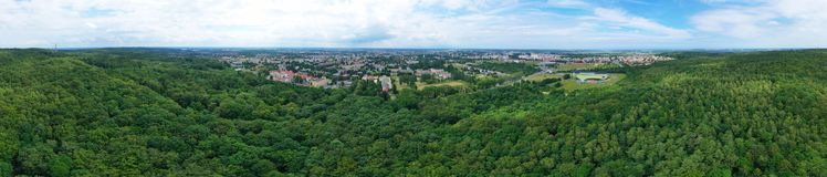 Free Aerial Drone Wide Panoramic View On Green Lungs Forest Surrounding European City During Summer, Aquapark Complex Royalty Free Stock Images - 161620449