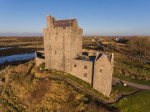 Aerial Dunguaire Castle Evening Sunset, near Kinvarra in County Galway, Ireland - Wild Atlantic Way Route. Famous irish castle. Royalty Free Stock Photo