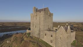 Aerial Dunguaire Castle Evening Sunset, near Kinvarra in County Galway, Ireland - Wild Atlantic Way Route. Famous public tourist a stock footage