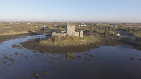 Aerial Dunguaire Castle Evening Sunset, near Kinvarra in County Galway, Ireland - Wild Atlantic Way Route. Famous public tourist a stock video footage
