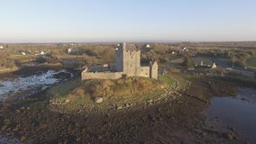 Aerial Dunguaire Castle Evening Sunset, near Kinvarra in County Galway, Ireland - Wild Atlantic Way Route. Famous public tourist a stock video
