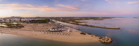 Aerial dusk panoramic view at Fuseta fishing town, in Ria Formosa. Wetlands nature conservation park, Algarve. Portugal Stock Image