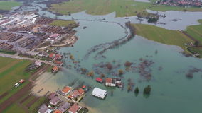 AERIAL: Environmental damage by flooding. Urban landscape stock video