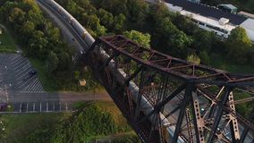 Aerial Establishing Shot of Coal Train on Railroad Bridge. 9277 A dynamic forward moving aerial establishing shot of a cargo trail traveling on a railroad bridge stock footage