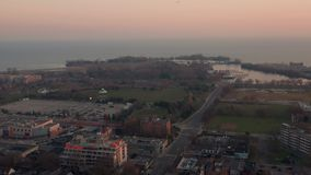 Aerial establishing shot of an east end Toronto neighbourhood at sunset.