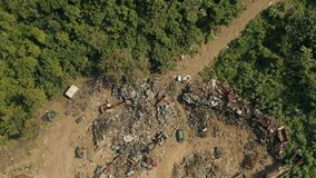 Aerial establishing shot of a junkyard.
