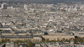 Aerial establishing shot of the Louvre in Paris. Panning left and right. daytime stock footage