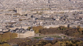 Aerial establishing shot of the luxembourg garden. Notre Dame is in the background. stock video