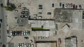Aerial establishing shot of an open air flea market.