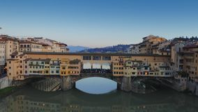 Aerial establishing shot of Ponte Vecchio bridge in Florence, Italy stock footage