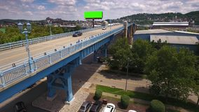Aerial Establishing Shot of 31st Street Bridge in Pittsburgh. 8757 A slow reverse aerial establishing shot of traffic and bicyclists on the 31st Street Bridge in stock video