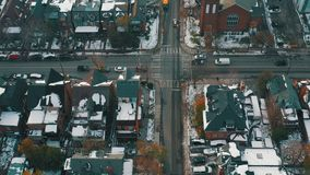 Aerial establishing shot of a Toronto neighborhood after a snowfall.