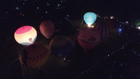 Aerial Evening hot air balloon glow and dance at the Kungur, Russia. Editorial use only 02. stock video