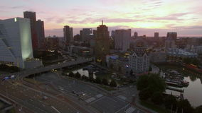 Aerial evening shot of Rotterdam cityscape and traffic stock video footage