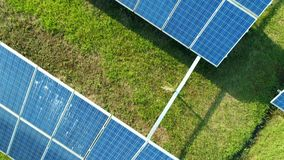 Aerial extreme close-up view of Solar Panels Farm solar cell with sunlight. Drone flight over solar panels field stock footage