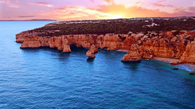 Aerial from famous beach Praia da Marinha in Portugal. Aerial from famous beach Praia da Marinha in the Algarve Portugal at sunset Royalty Free Stock Photo