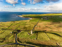 Aerial Famous Irish Tourist Attraction In Doolin, County Clare, Ireland. Doonagore Castle is a round 16th-century tower Castle. Aran Islands and along The Wild Stock Photos