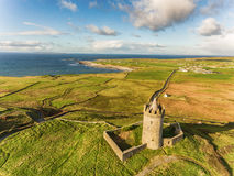 Aerial Famous Irish Tourist Attraction In Doolin, County Clare, Ireland. Doonagore Castle is a round 16th-century tower Castle. Aran Islands and along The Wild Royalty Free Stock Image