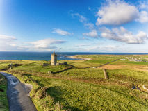 Aerial Famous Irish Tourist Attraction In Doolin, County Clare, Ireland. Doonagore Castle is a round 16th-century tower Castle. Aran Islands and along The Wild Royalty Free Stock Photography