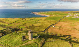 Aerial Famous Irish Tourist Attraction In Doolin, County Clare, Ireland. Doonagore Castle is a round 16th-century tower Castle. Aran Islands and along The Wild Stock Photo