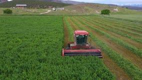 Free Aerial Farm Field Swather Cutting Alfalfa Hay Pull Fast Motion 4K Royalty Free Stock Photo - 187908765