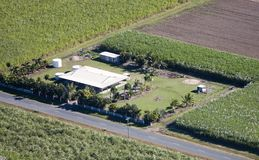 Aerial of farm house. Aerial of sugar cane farm house in Queensland, Australia Royalty Free Stock Image
