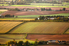 Aerial farmland fields. And meadows at sunset in England, UK Stock Photo