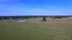 Aerial farmland flyover stock video