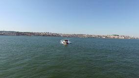 Aerial from ferry boats on the river Tejo Lisbon Portugal stock video