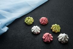 Aerial festive meringue cakes on a black background.  royalty free stock images