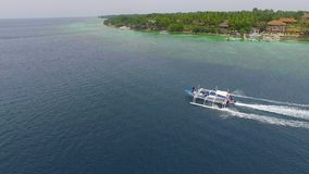 Aerial: Filipino Boat Moving In The Beautiful Tropical Sea In Moalboal, Cebu. Drone Shot Of Filipino Boat Moving In The Beautiful Tropical Sea At Summer stock video