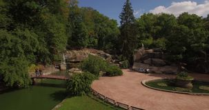 Aerial filming in picturesque and romantic dendrological park stock video