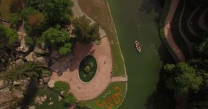 Aerial filming in picturesque and romantic dendrological park stock video footage