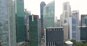 Aerial filming of the skyscrapers in Singapore`s financial district during the daytime. stock footage