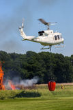 Aerial fire fighting helicopter stock image