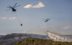 Helicopters extinguish forest fire in Croatia royalty free stock photos