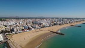 Aerial. Fishing port and beach of Quarteira dropped from the sky. stock footage