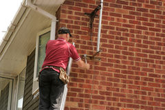 Aerial fitter on ladder. TV Aerial fitter working up ladder Stock Images