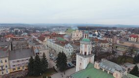 Aerial: flag waving while camera orbits with downtown. Aerial perspective. Sambor Ukraine. 4k stock footage