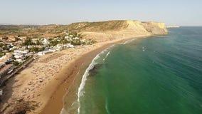 aerial Fliegen über den Strand Luz in Lagos stock video footage