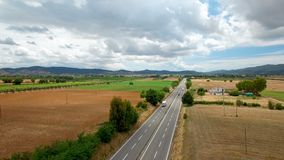 Aerial flight over the highway and bridge with vehicles. Aerial view on the mountains in Tuscany, Italy. Aerial flight over the highway and bridge with vehicles stock video footage