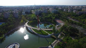 Aerial flight above Moghioros park in Bucharest city, Romania. Hd video stock footage