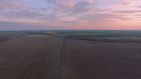 Aerial flight above rural path at High voltage power line. Aerial flight above rural path. High voltage power line in the field at forest and river near stock footage