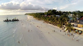 Aerial flight above white beach and Willy's Rock at Boracay Beach stock video footage