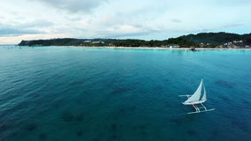 Aerial flight above white beach and Willy's Rock at Boracay Beach stock footage