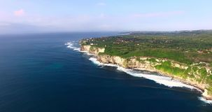Aerial flight with camera looking straight down over the coast line. Uluwatu, Bali stock video footage