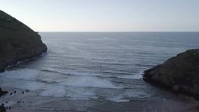 Aerial flight out to the ocean over beach at Atlantic in Spain. Sonabia Basque close to Bilbao stock footage