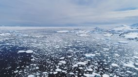 Aerial flight over Antarctica ice frozen ocean. Climate Change: Melting Ice. Aerial Flight Over Antarctica Ice Frozen Ocean Water. Drone Overview Shot Of Polar stock video footage