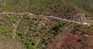 Aerial. Flight Over Curvy Road in Mountains stock footage
